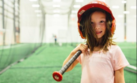 Young Girl Playing baseball