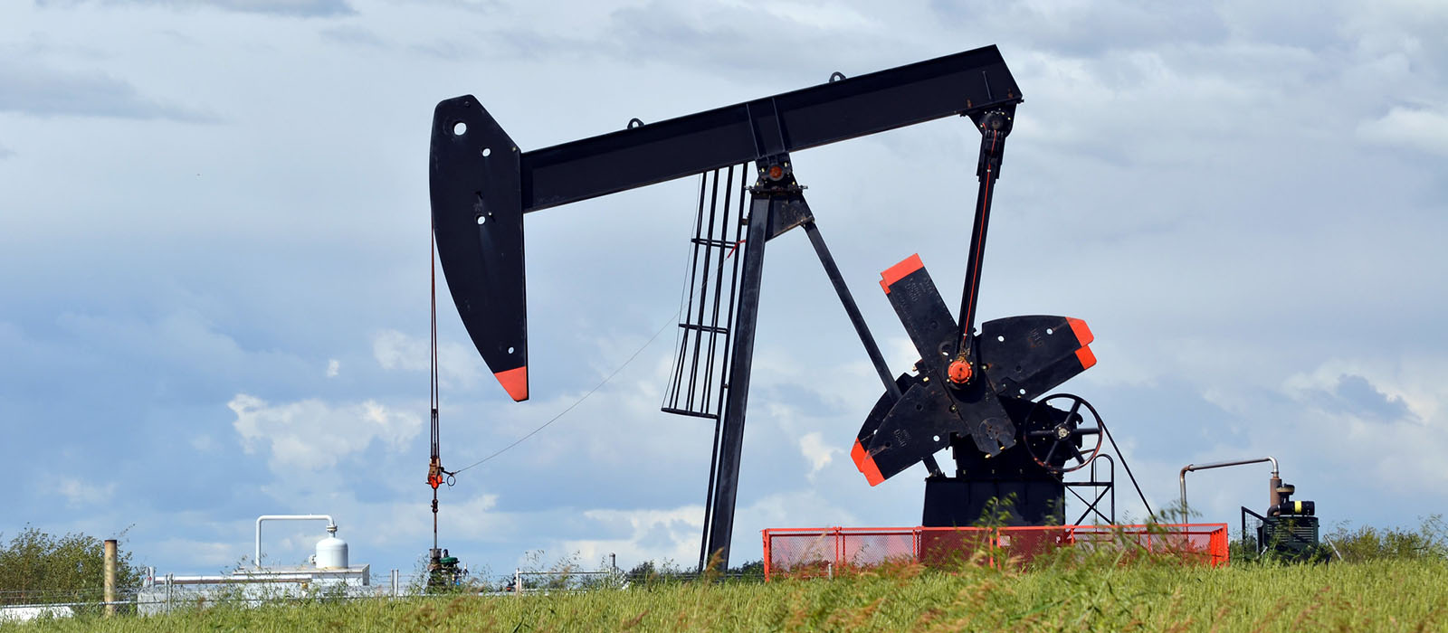 Oil pumpjack against a blue sky